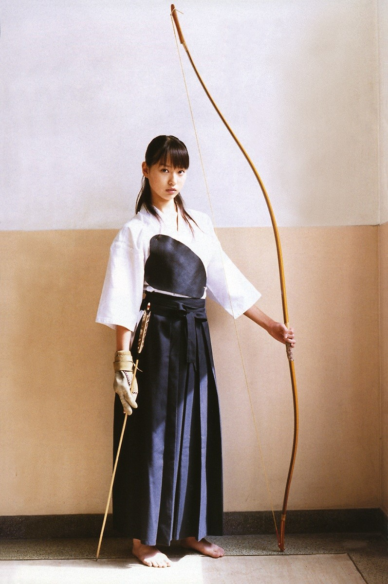 Girl With Huge Bow And Arrows