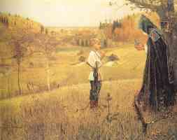 priest and boy on a hill