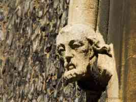 stone head by church window