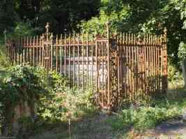 grave secured with iron fence