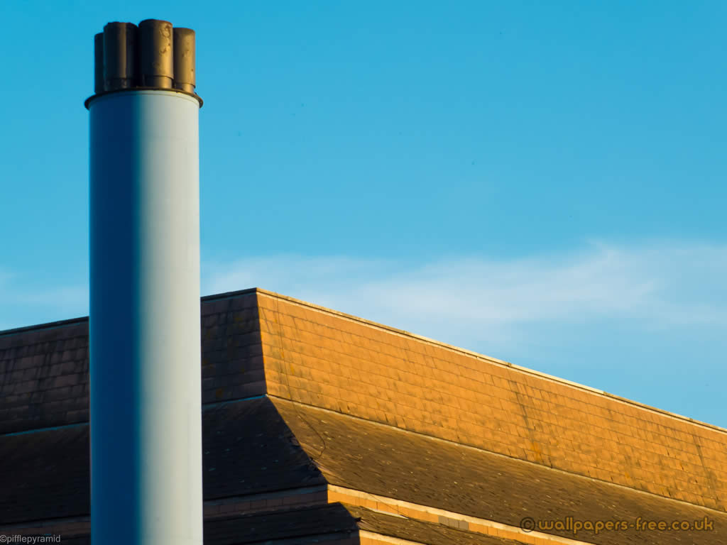 Factory Building With Blue Chimney