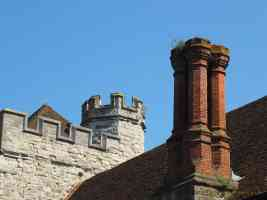 old tall chimney and battlements