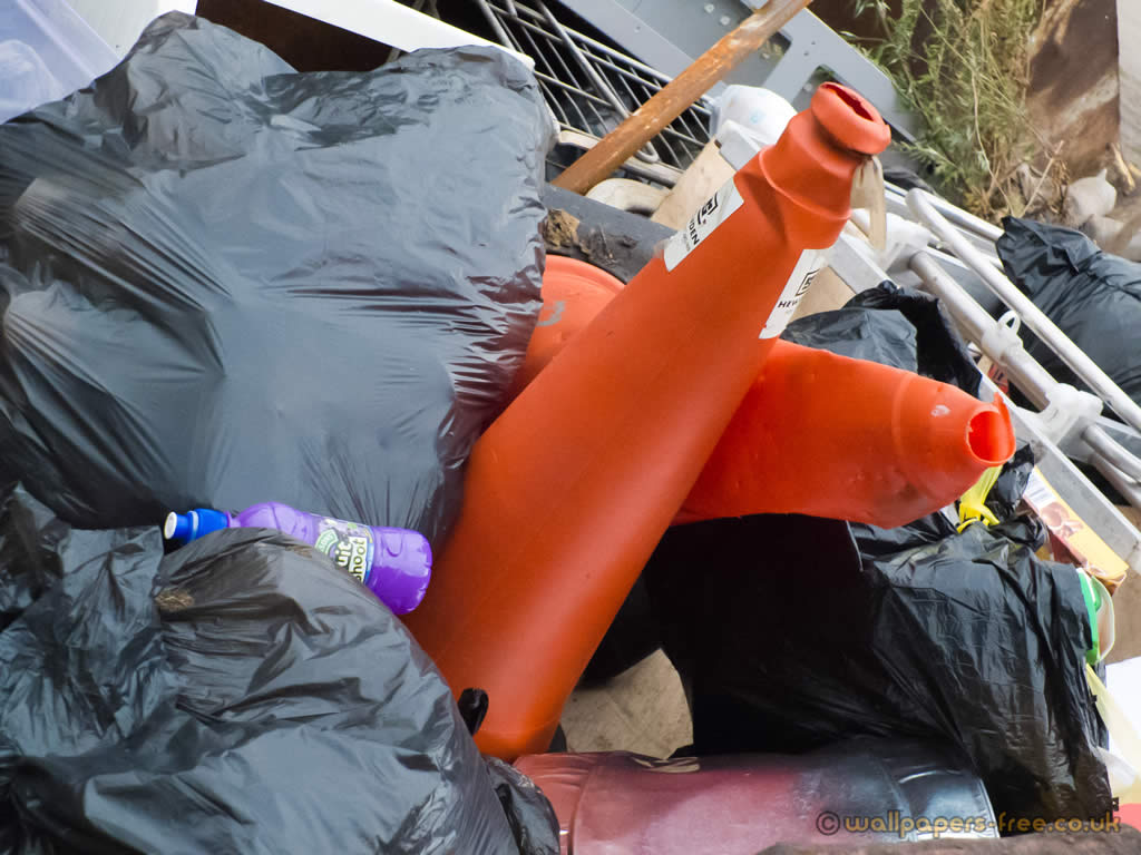 Pile Of Rubbish With Traffic Cones