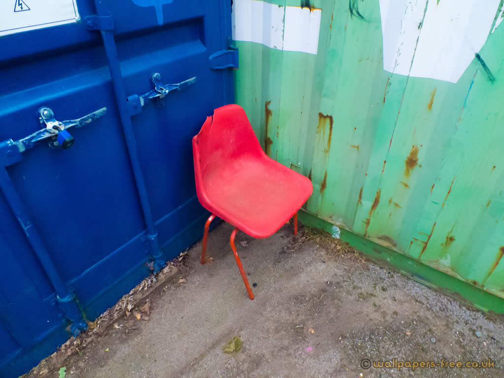 Red Chair Blue Container And Green Container