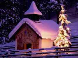 snowy church and xmas tree