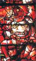 stained glass window showing the devil in hell