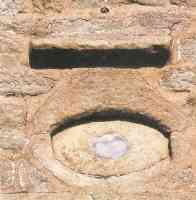 eye of god with slate pupil on wall