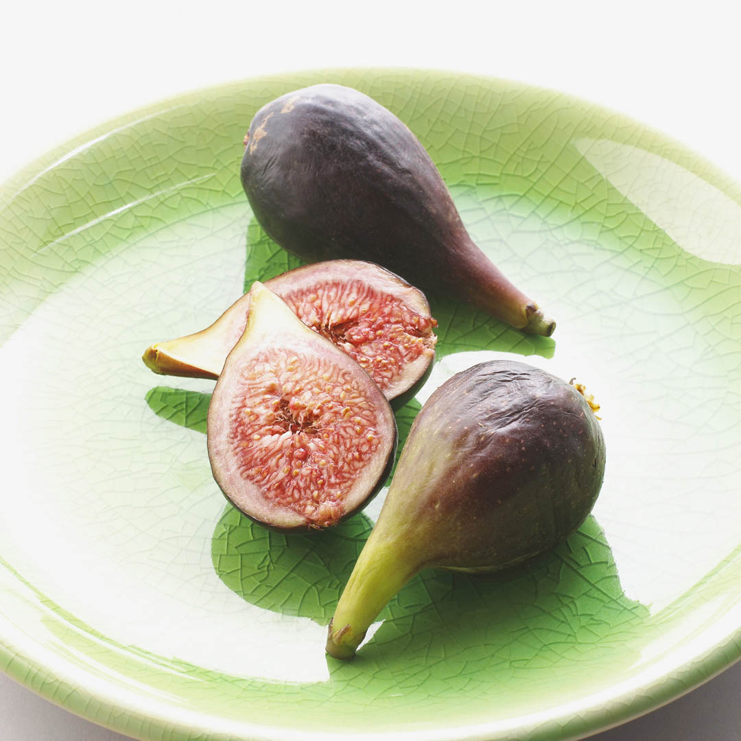Halved And Whole Fresh Figs