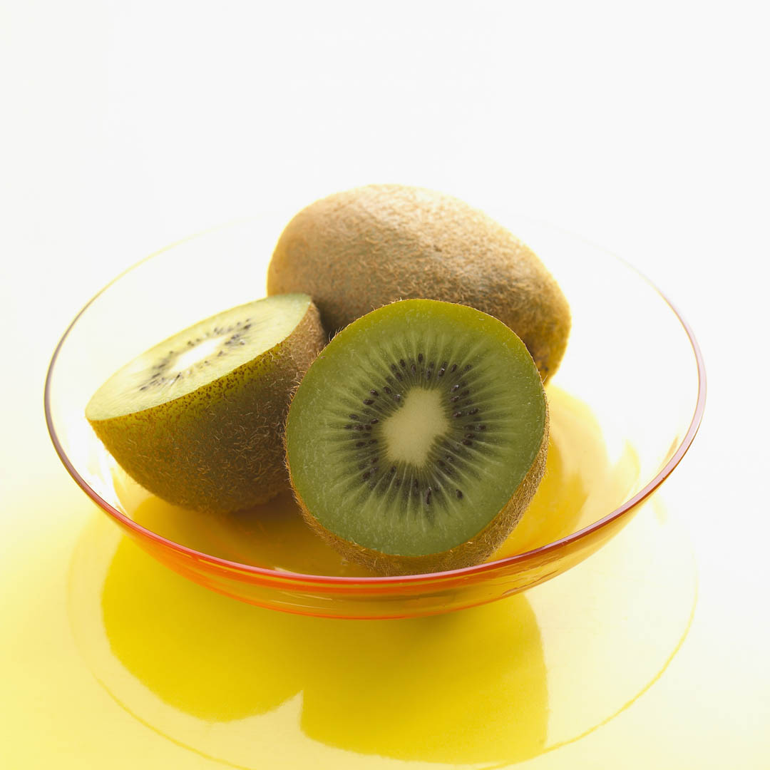 Halved And Whole Kiwi Fruits