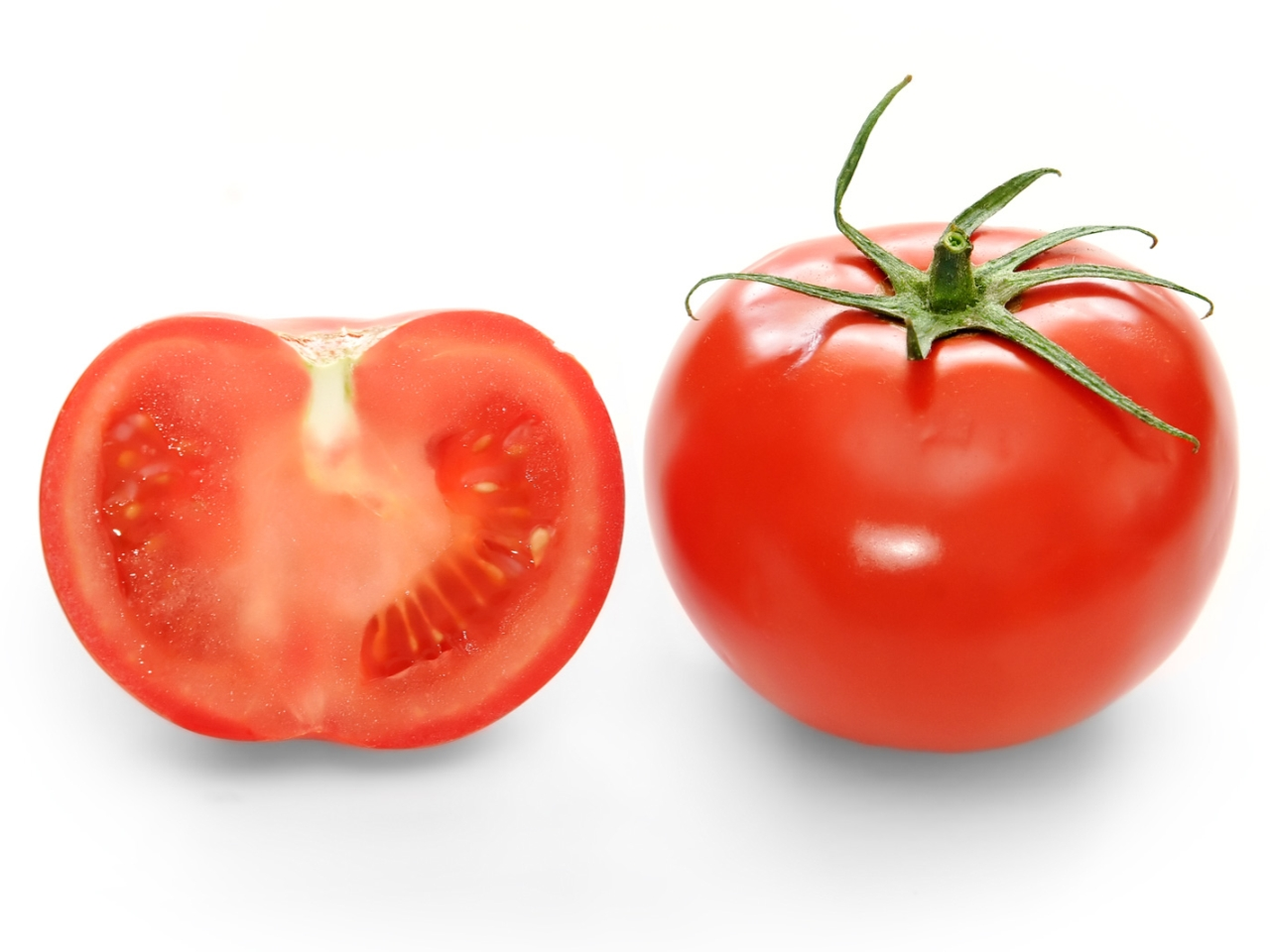 Bright Red Tomato And Cross Section