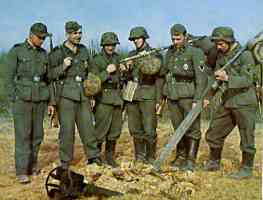 German soldiers inspect a dud bomb