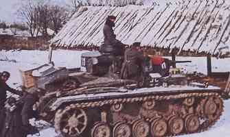Panzer III tank on the rise in a Russian village
