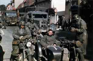Sidecar motorcycle with crew at rest