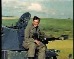 soldier with captured German Panzer tank