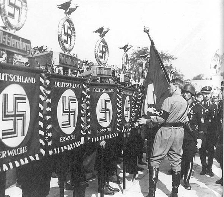 Hitler Checking The Nazi Standards