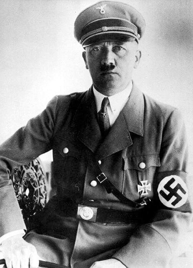 Hitler Sitting In Nazi Uniform - Nazi Third Reich Wallpaper