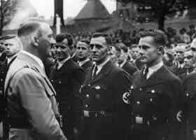 adolf hitler welcomes the werkscharmanner men of work troop to nuremberg