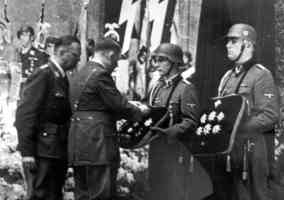hilter giving medals to soldiers