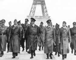 hitler and his henchmen walking the champs elysee