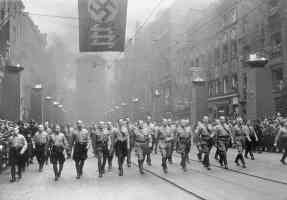 hitler and nazi party marching through the streets