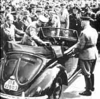 hitler entering a soft top vw beetle