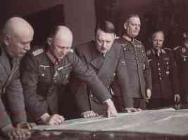hitler mussolini and others looking at a map