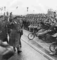 hitler saluting war wounded soldiers in their wheelchairs