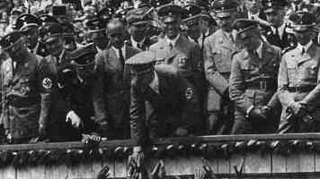 hitler shaking hands with the crowd