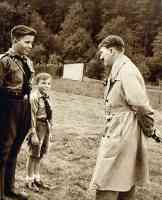 hitler talking to two boys from hitler youth