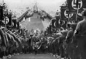 hitler walking up steps at nazi rally