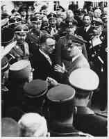 people of vienna look on as adolf hitler talks with dr arthur seyss inquart