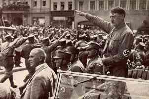saluting fron back of a car at a rally