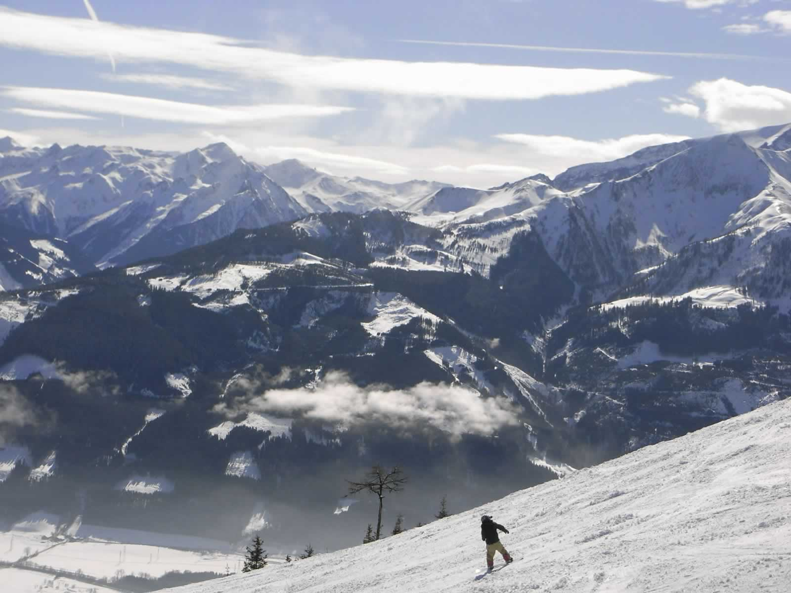 Zellamsee Snowy Mountains And Snowboarder