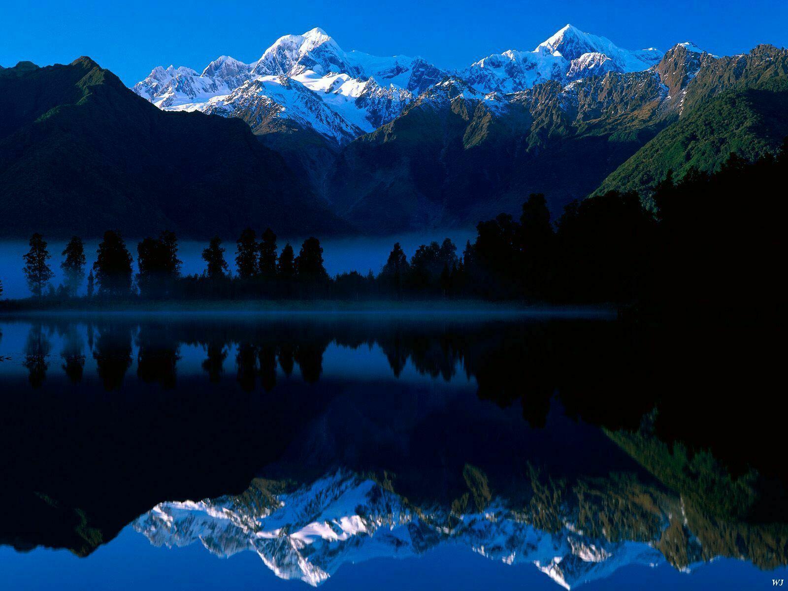 Landscape Lake Matheson Reflects Mount Tasman And Mount Cook New Zealand