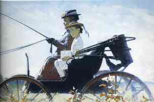 girl and lady riding on carriage