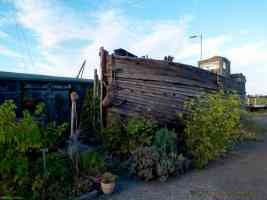 wooden garden shack and old boat