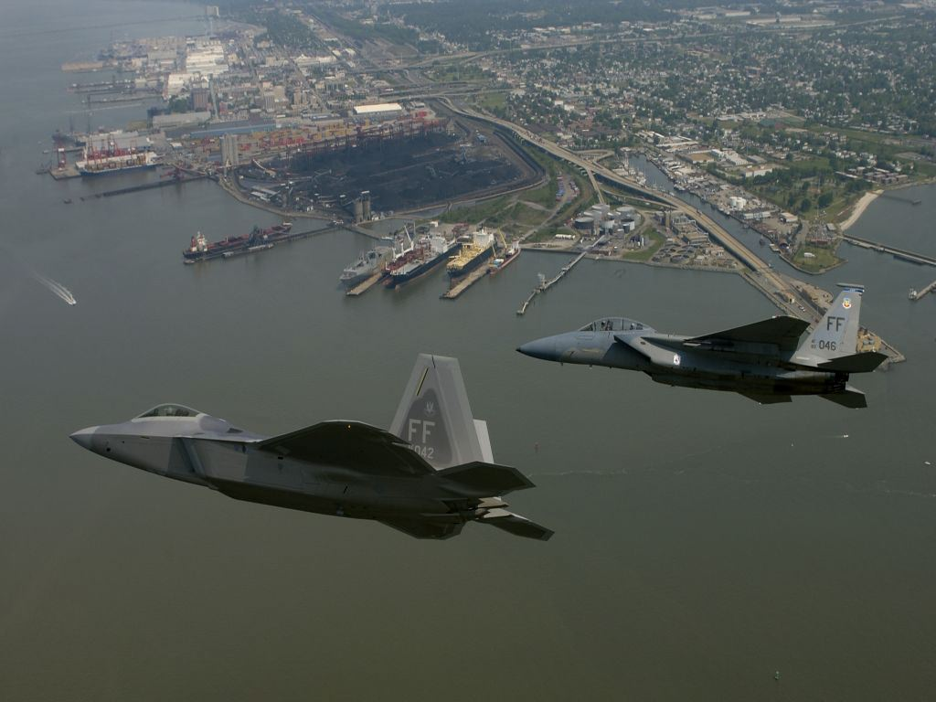 FA22 And F15 Over The City