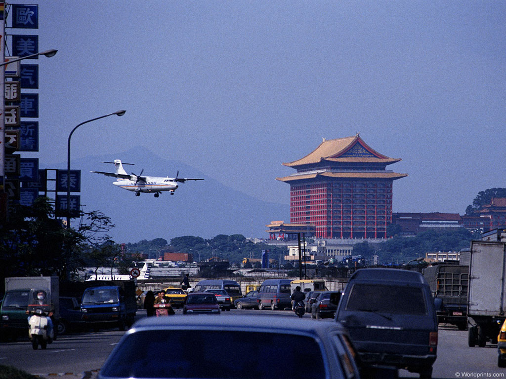 Airplane Coming To Land In Chinese City