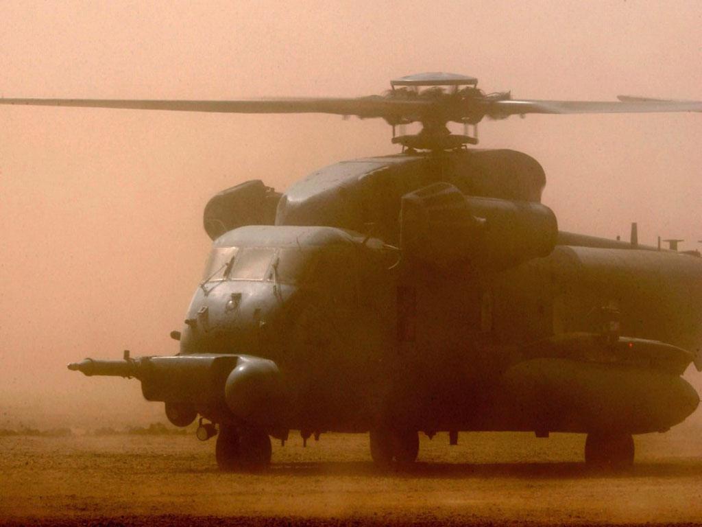 Chopper Landing In Dust Cloud
