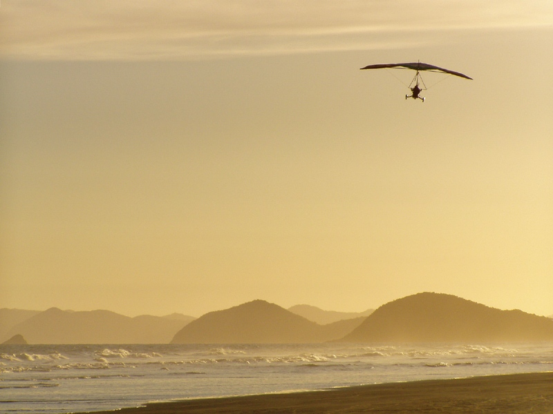 Hang Glider Over The Beach