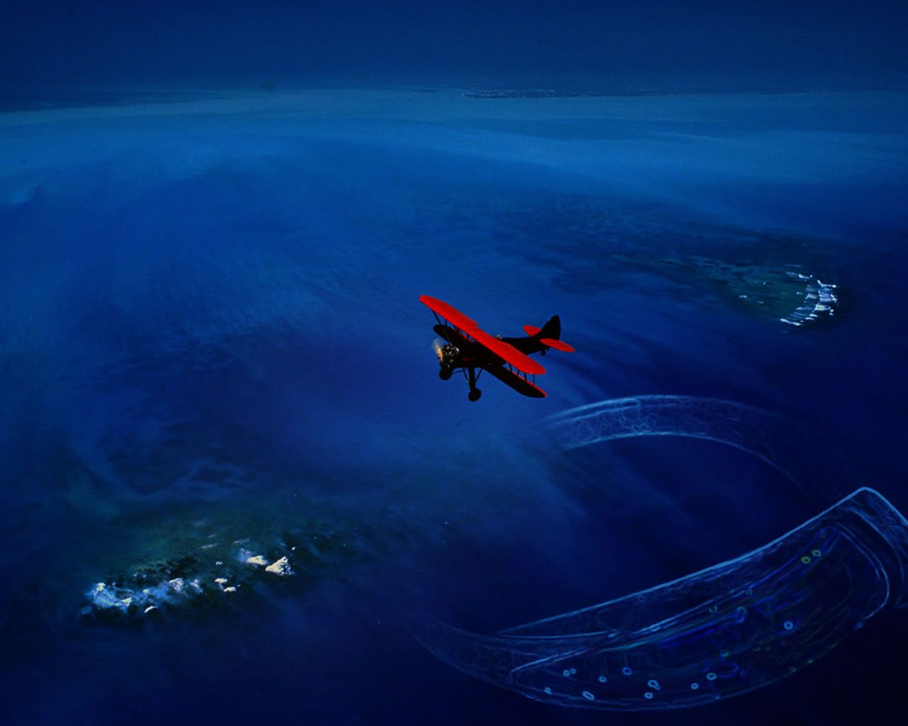 Red Biplane Over The Deep Blue Sea