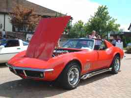 1969 Chevrolet Corvette 427 Coupe with Chrome Side Pipes Monza Red fvl Canterbury Village Car Show F