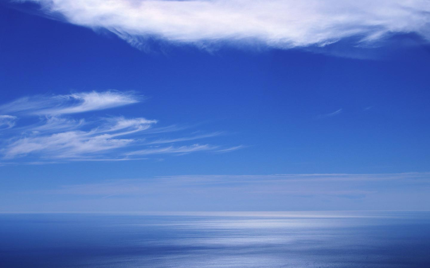 Blue sea horizon weather wallpaper image featuring clouds