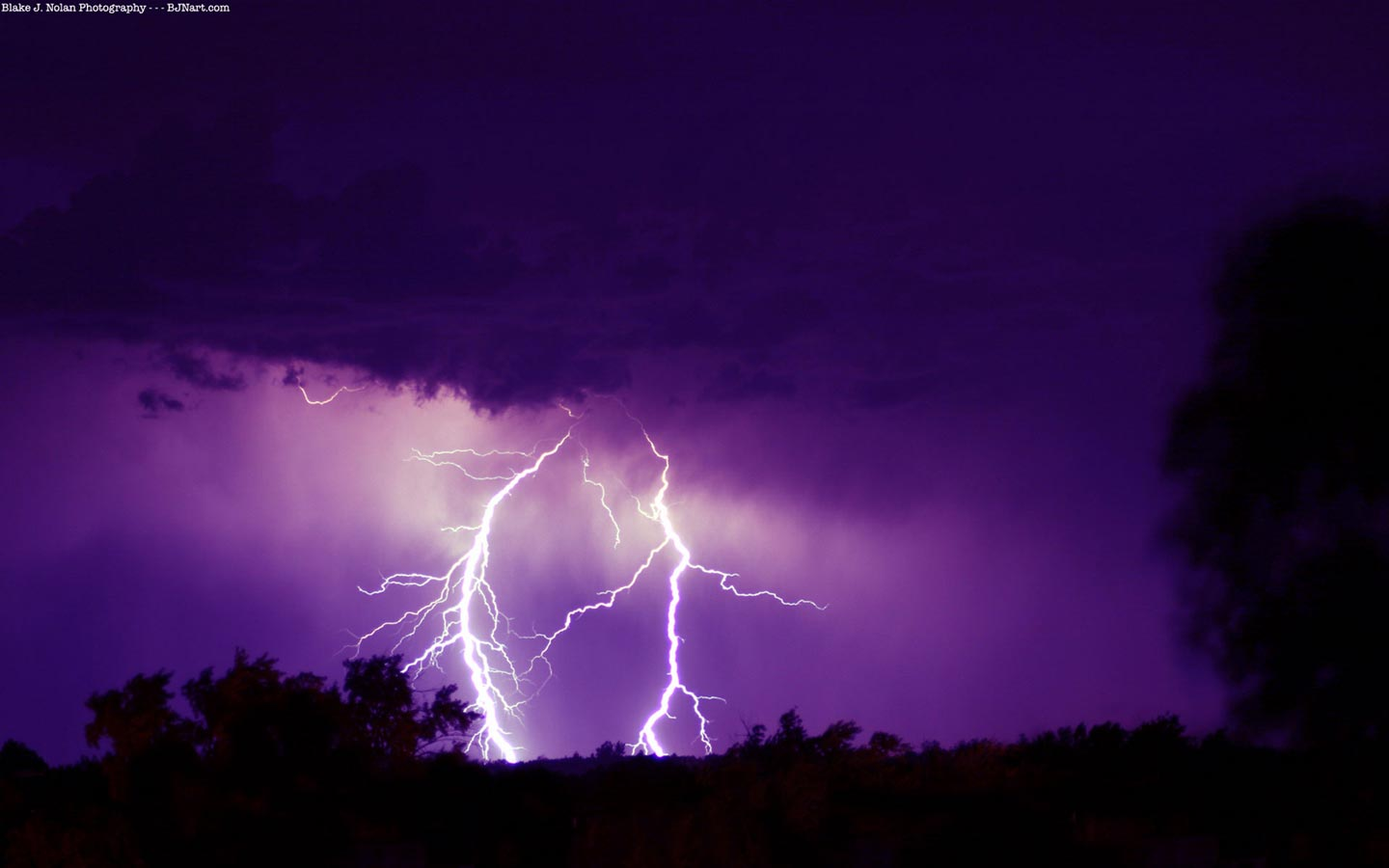 Purple lightning weather wallpaper image featuring lightning