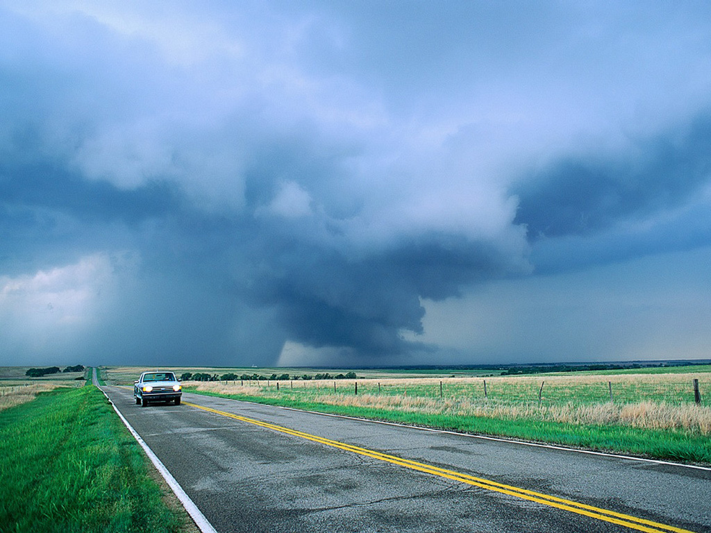 Pickup Truck Driving From Storm