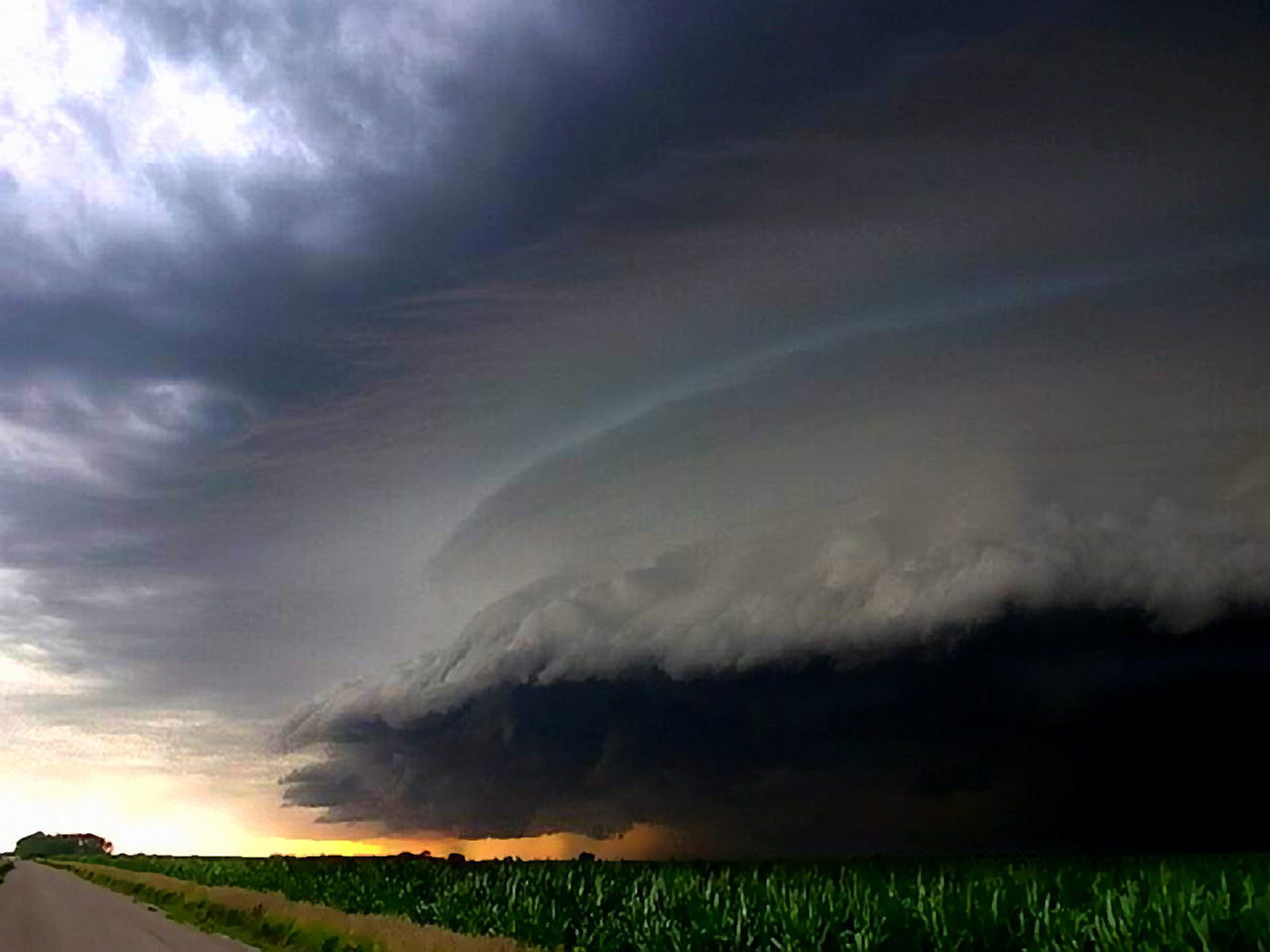 Large wall cloud weather wallpaper image featuring tornadoes