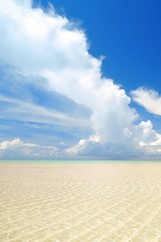 Cloudy Blue Sky And Sand
