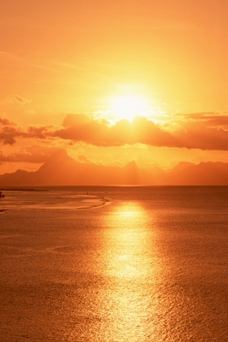 Ocean Golden Yellow Sunlight Reflecting Across The Sea